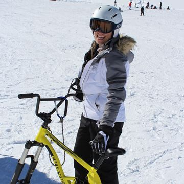 Girl with ski bike